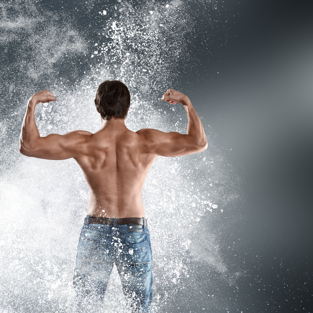 Muscle man with flour showing strength