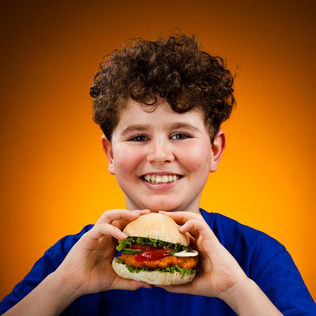 Boy eating healthy sandwich