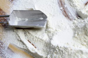 Metal scoop and flour