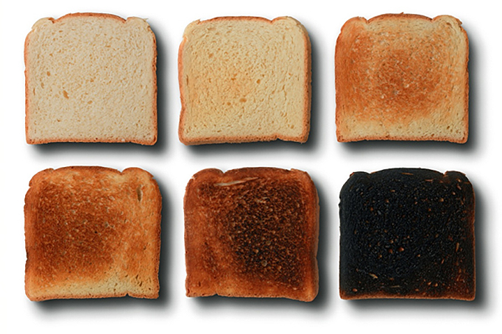Six slices of toast of varying shades