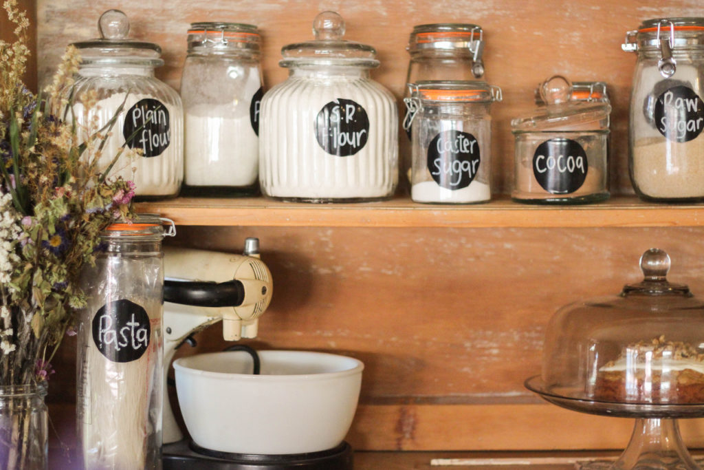 Store flour in glass jar on shelf just as you would with other dry ingredients. An air tight container on a shelf or in a cupboard in a cool part of your kitchen..