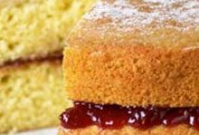 cut sponge cake with dripping jam